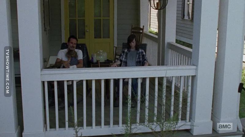 Just look at this utopia... A beautiful day on the porch, lemonade, a baby... Negan without his jacket on.   Damn!