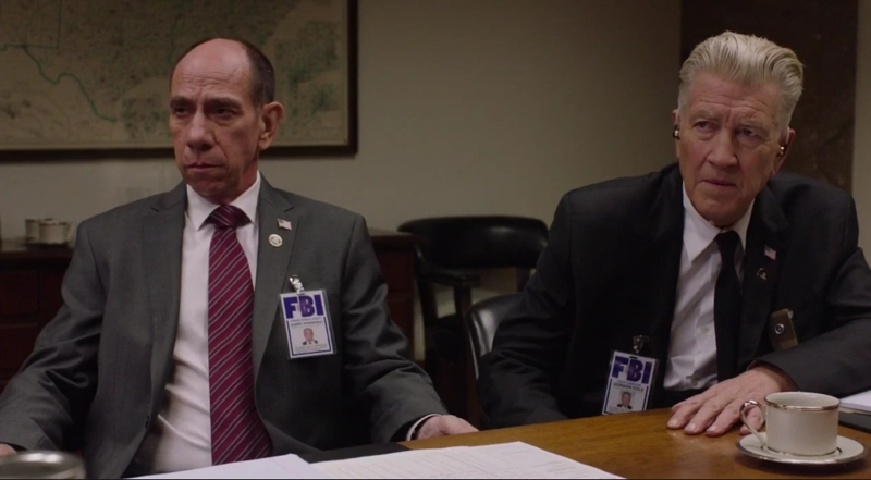 Poor him, he was alive when they were shooting this season.  RIP Miguel Ferrer