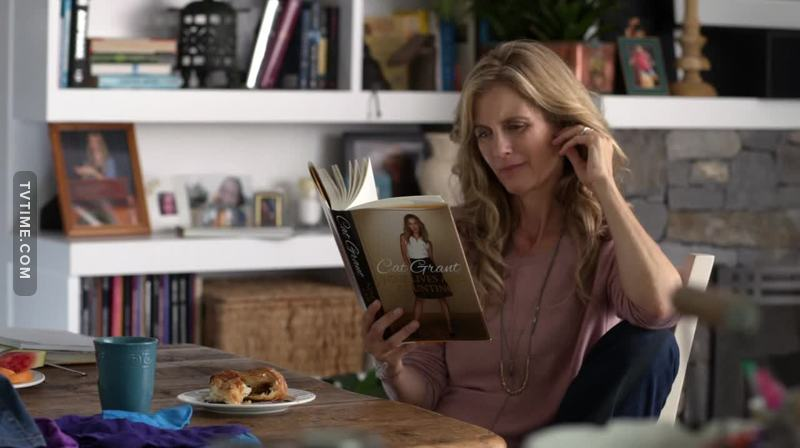 *Easter egg ALERT* Eliza reading Cat Grant's book: Nine Lives and Counting (Rao, I love those tiny little easter eggs)